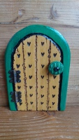 Teeny greeny fairy door with vintage button