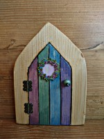 Fairy door with floral wreath in colour washed stripes
